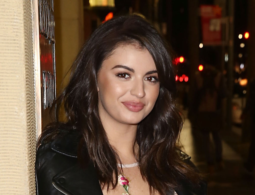Rebecca Black glides like a fairy queen in this totally sheer floral dress