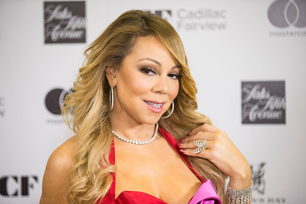 Queen of glam Mariah Carey wore a bikini and boots with da fur to show off her gigantic Christmas tree