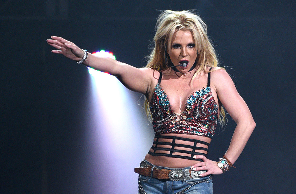 Britney Spears hilariously posing before a Jingle Bash meet and greet is all of us