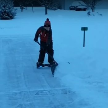 This kid shoveling snow on a hoverboard is scary and impressive at the same time