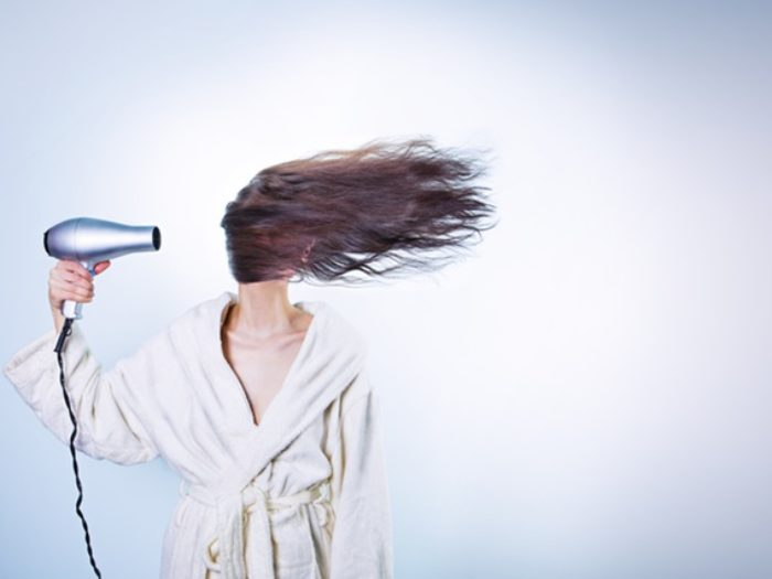 There's a reason why your hair might actually hurt when you don't wash it for a few days