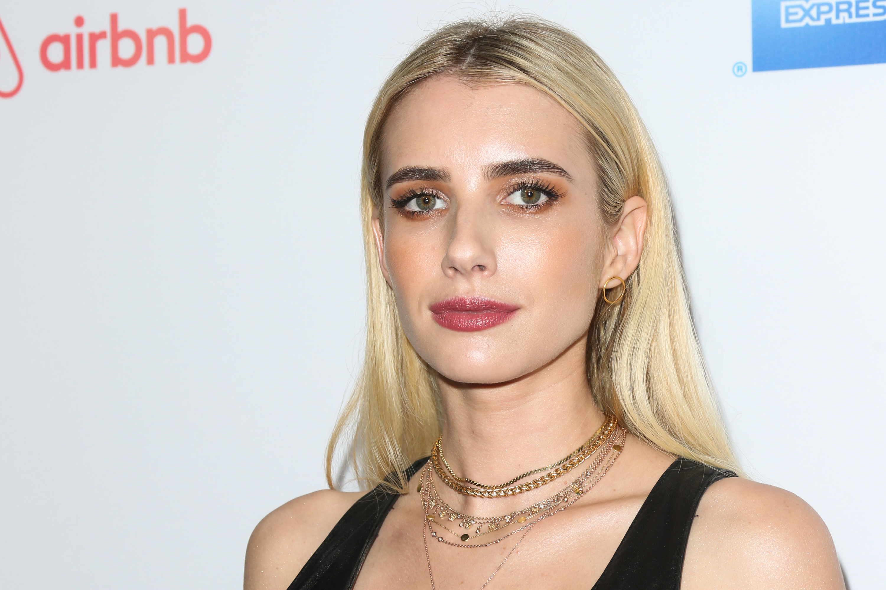 Emma Roberts looks like an '80s biker girl in her monogrammed leather jacket