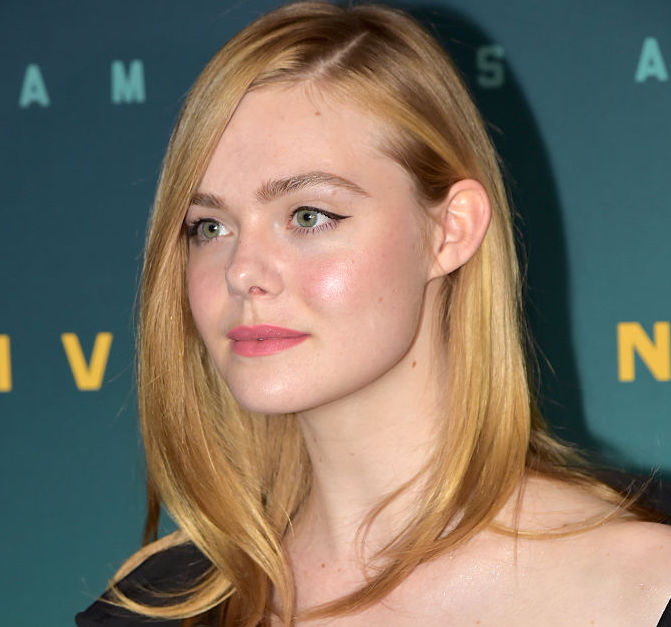 Elle Fanning's unbuttoned off-the-shoulder black gown is the definition of chic