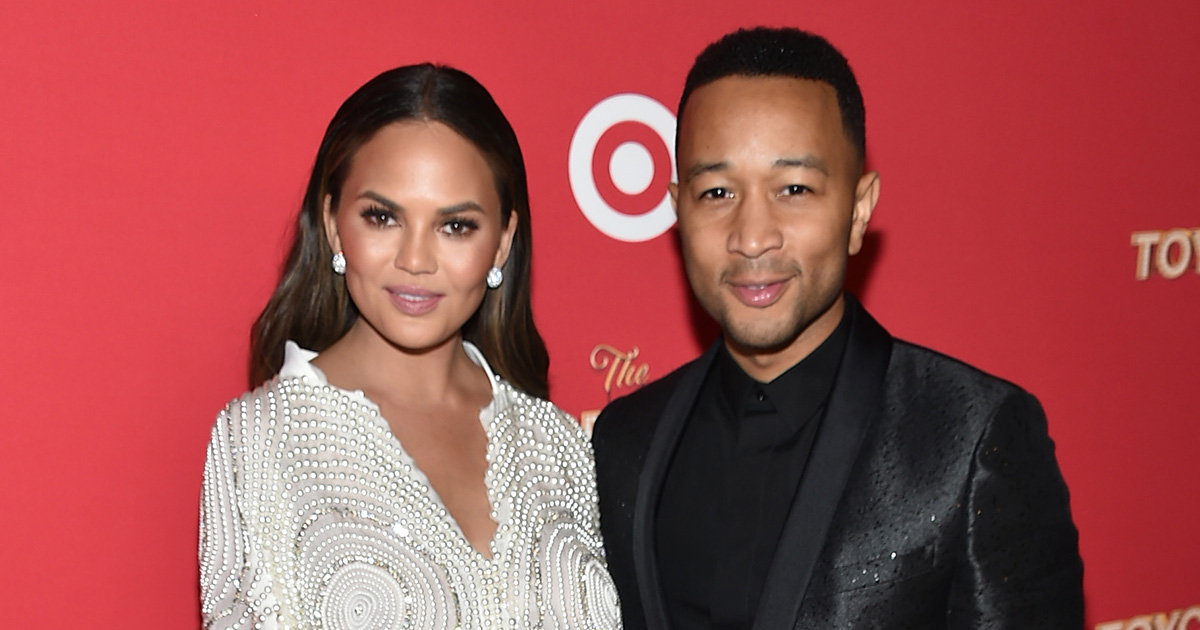 """Chrissy Teigen shared a """"family"""" holiday photo, but there's something not quite right about it"""