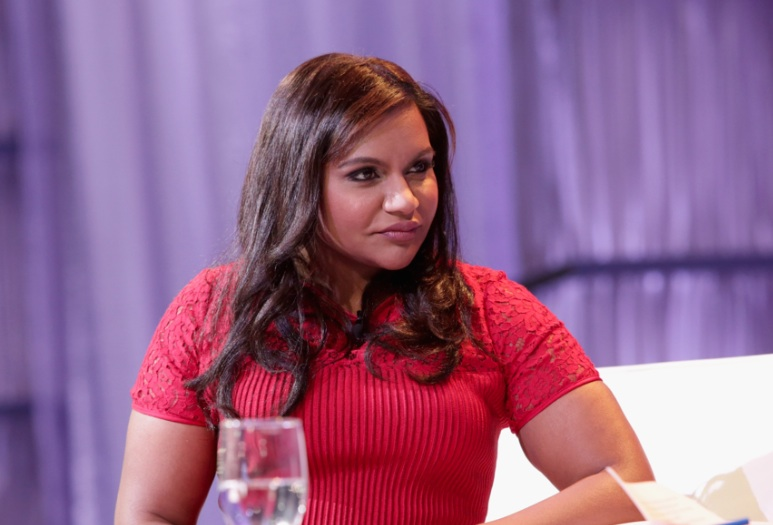 Mindy Kaling KILLED IT in this simple white dress and black heels, and we have major style envy right now
