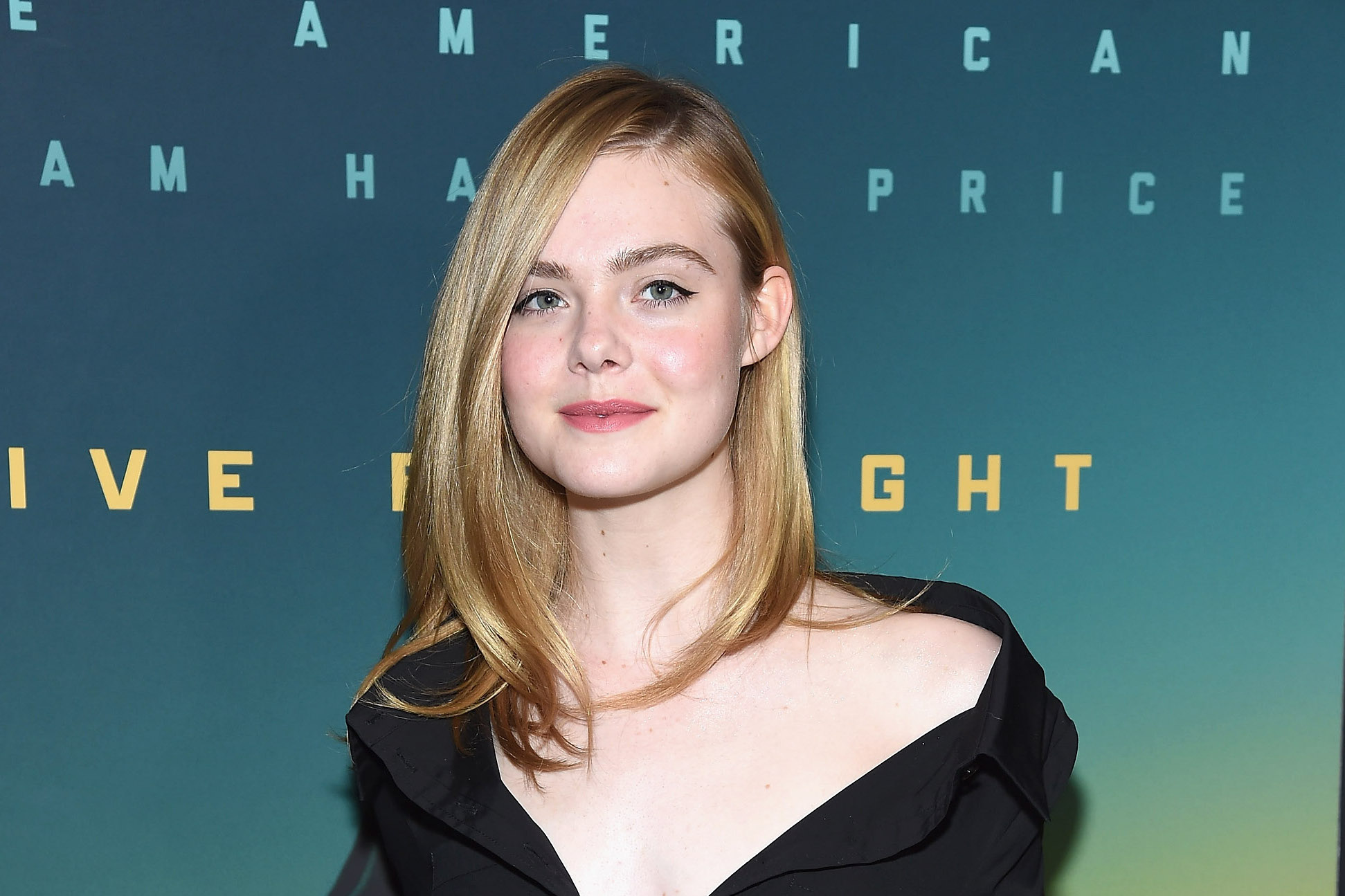 Elle Fanning looks like she's on her way to cast some spells in this gothic winter outfit