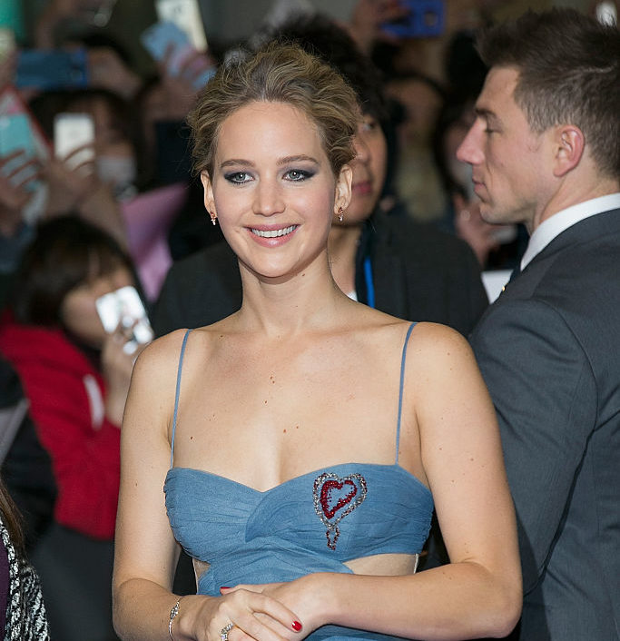 Jennifer Lawrence's most awesome dress yet comes with its own sword and we're obsessed
