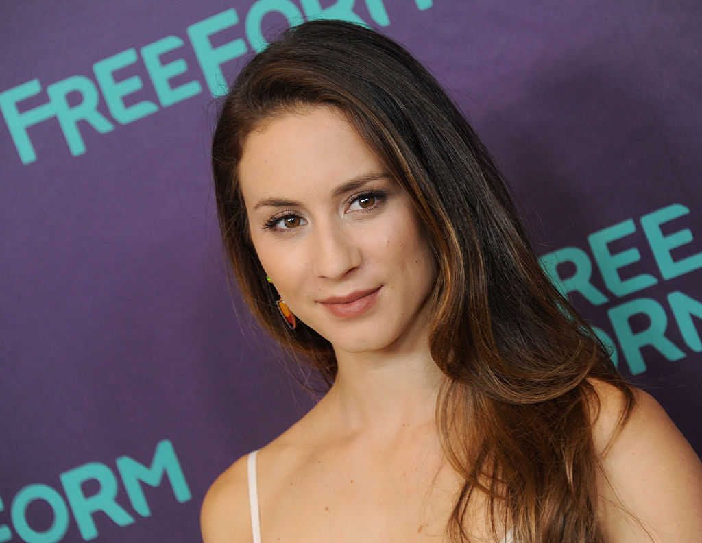 Troian Bellisario explains why she picked her wedding dress and it makes perfect sense