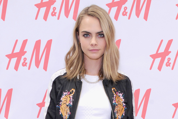 Cara Delevingne posted a slo-mo video of a fan blowing into her face and we can't stop laughing