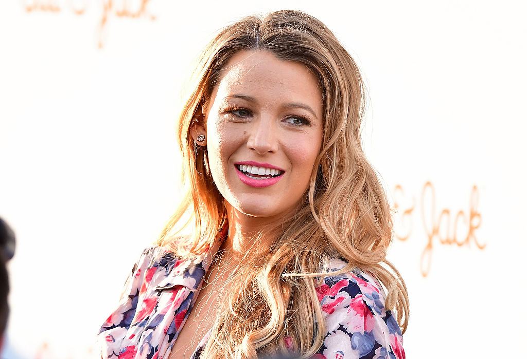 No one has ever looked happier at Disneyland than Blake Lively in this photo with Mickey Mouse