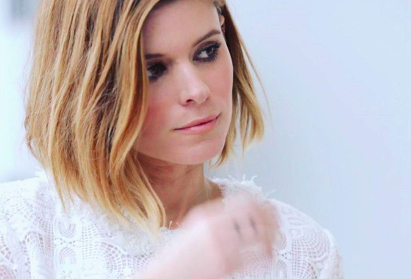 Kate Mara's pretty and dusty pink coat served up major vintage vibes