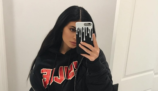 Kylie Jenner's gold top and pants with black lace accents are giving us so very many holiday goals