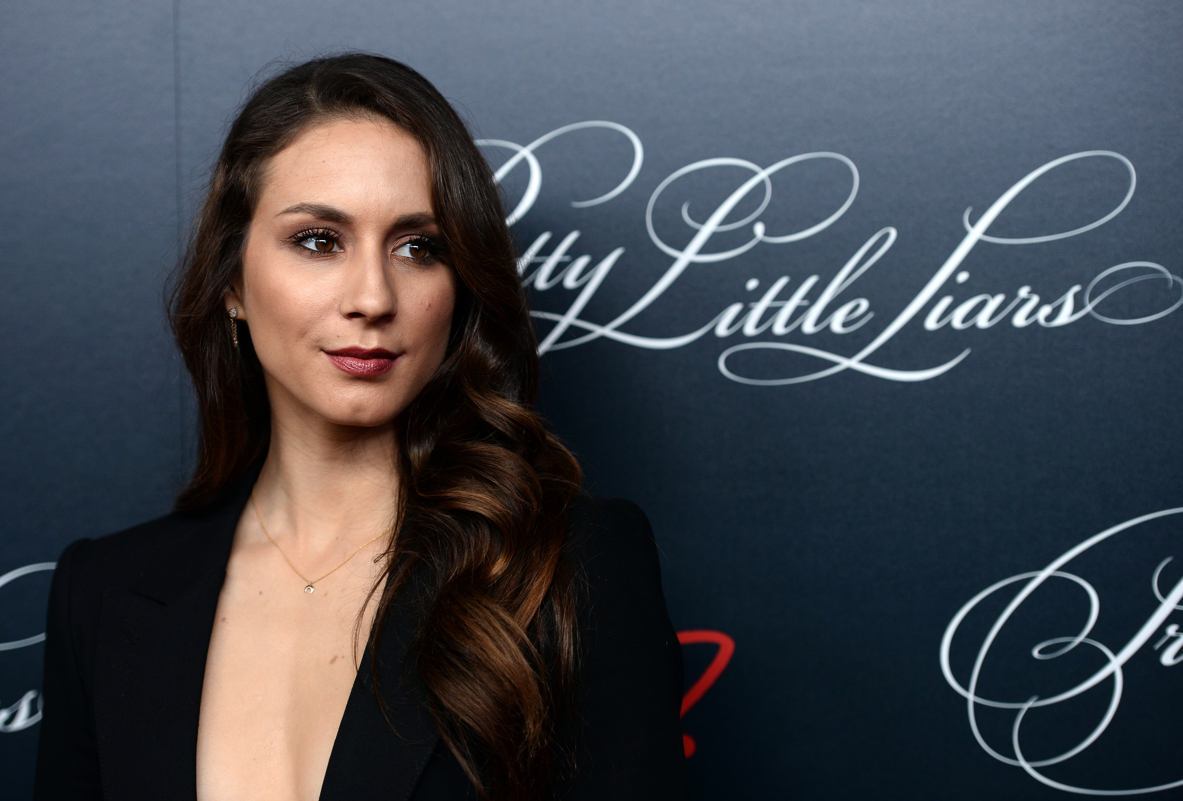 Troian Bellisario had a ~secret~ wedding dress and it's even more amazing than the first