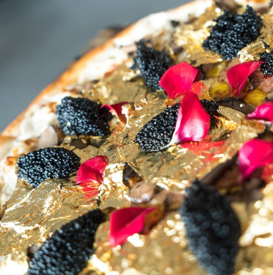 This $2,000 pizza topped with gold flakes is the most glam food that's ever existed