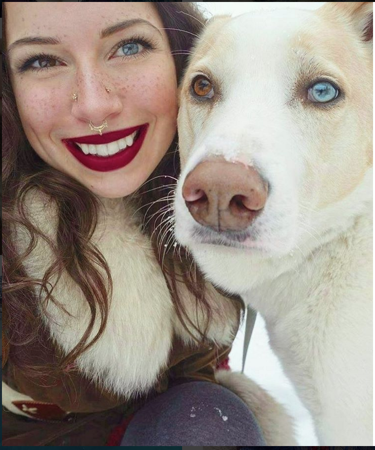 This pic of a woman and dog with heterochromia is reminding the internet that differences are beautiful