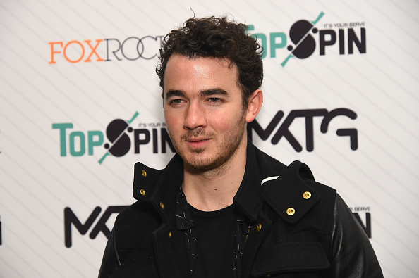 Let these photos of Kevin Jonas holding a duck at a holiday party put a smile on your face today