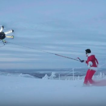 Here's video of a drone carrying a guy wearing a Santa suit and the footage is mind-blowing