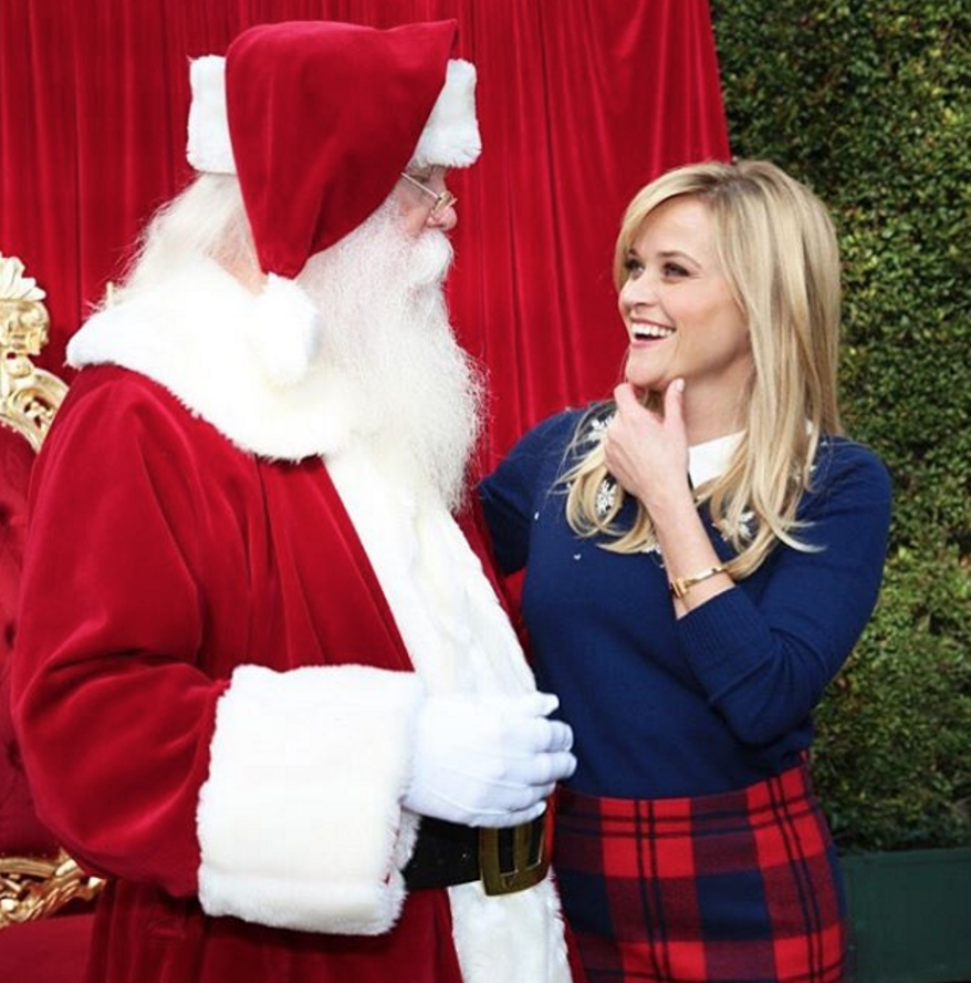 Reese Witherspoon is basically Buddy the Elf in these behind-the-scenes shots from her family Christmas