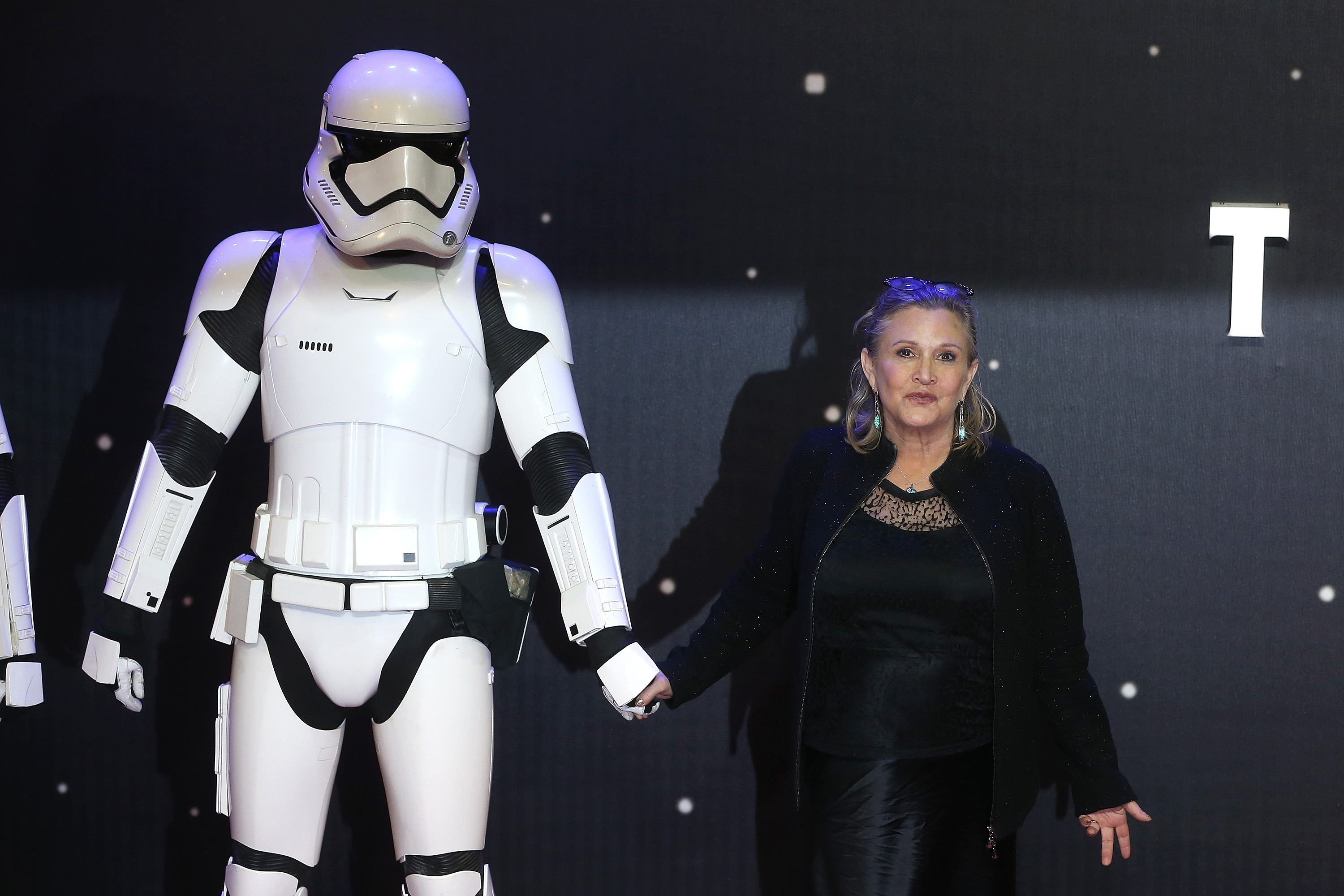 "The ""Star Wars"" family reacts to the Carrie Fisher news and our hearts are so heavy"