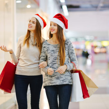 11 stock images of ladies Christmas shopping while wearing a Santa hat, because obviously this is a thing