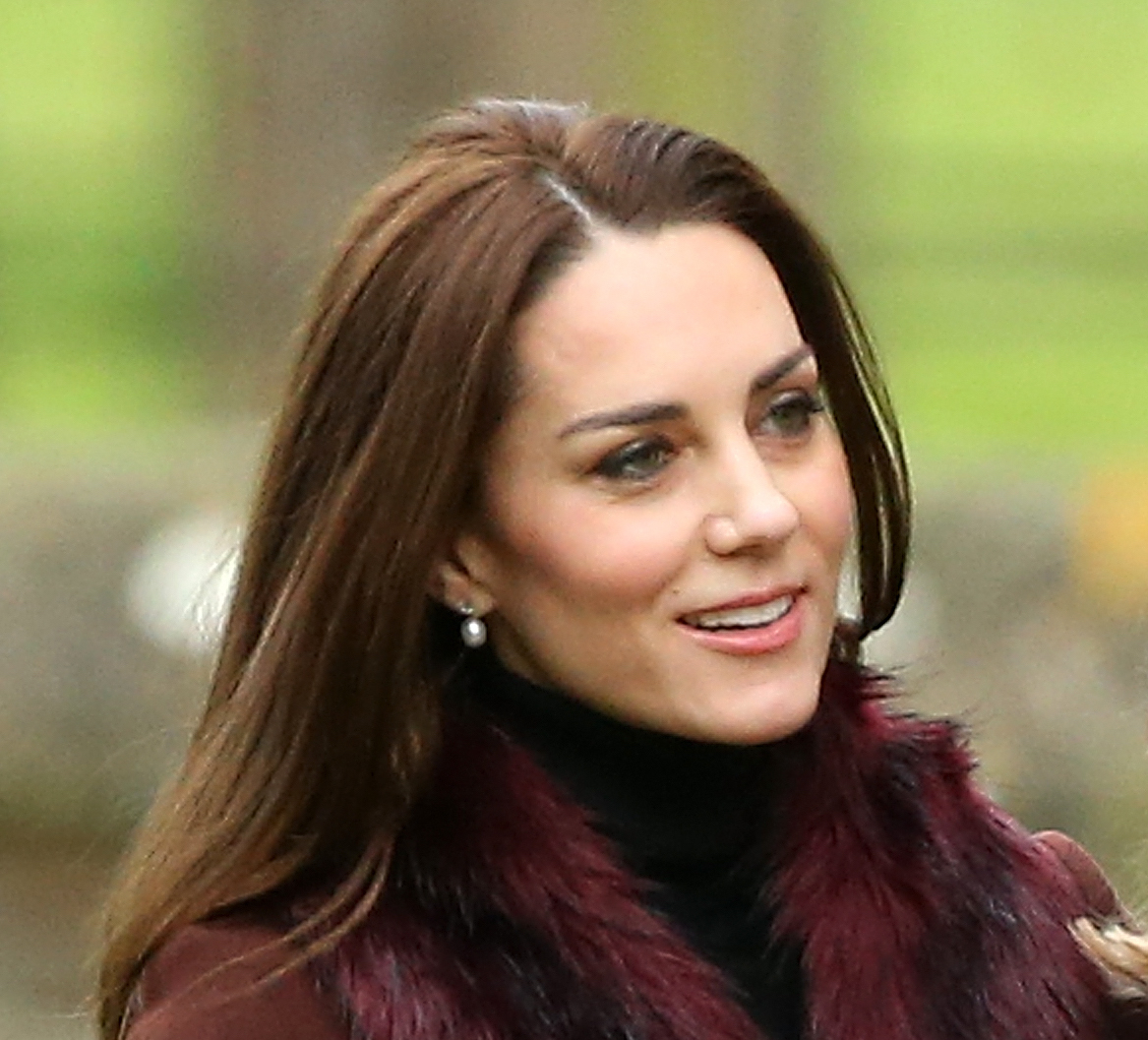 Can we all take a moment to obsess over Kate Middleton's fabulous burgundy holiday coat?
