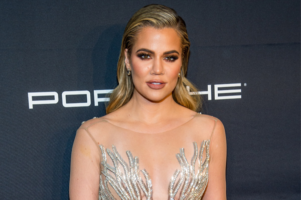 Khloé Kardashian looks like a disco babe from the '70s in her blue sequined tracksuit