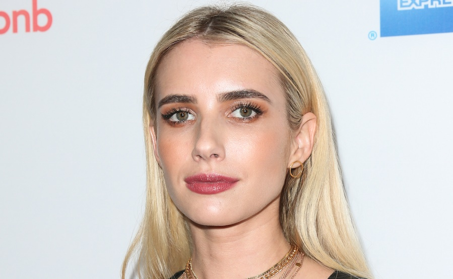 Emma Roberts makes shopping look so freaking chic in this all-black ensemble with leopard-print coat