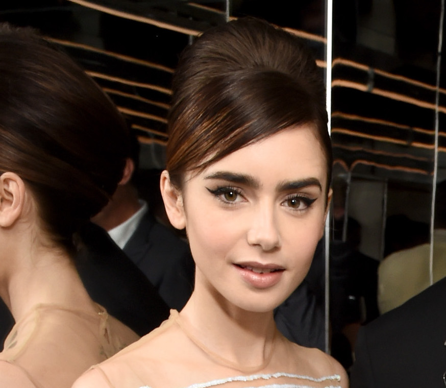 Lily Collins channeled style icon Jackie O. in this stunning transluscent dress