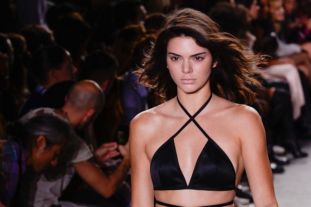 Kendall Jenner looks like a chic Big Bird in this giant yellow robe