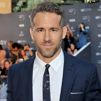 Ryan Reynolds is sitting exactly where we wish we could at the Golden Globes