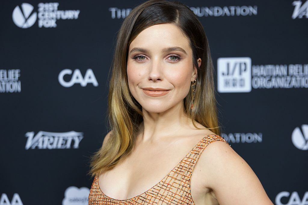 Sophia Bush stunned in an orange gold textured dress