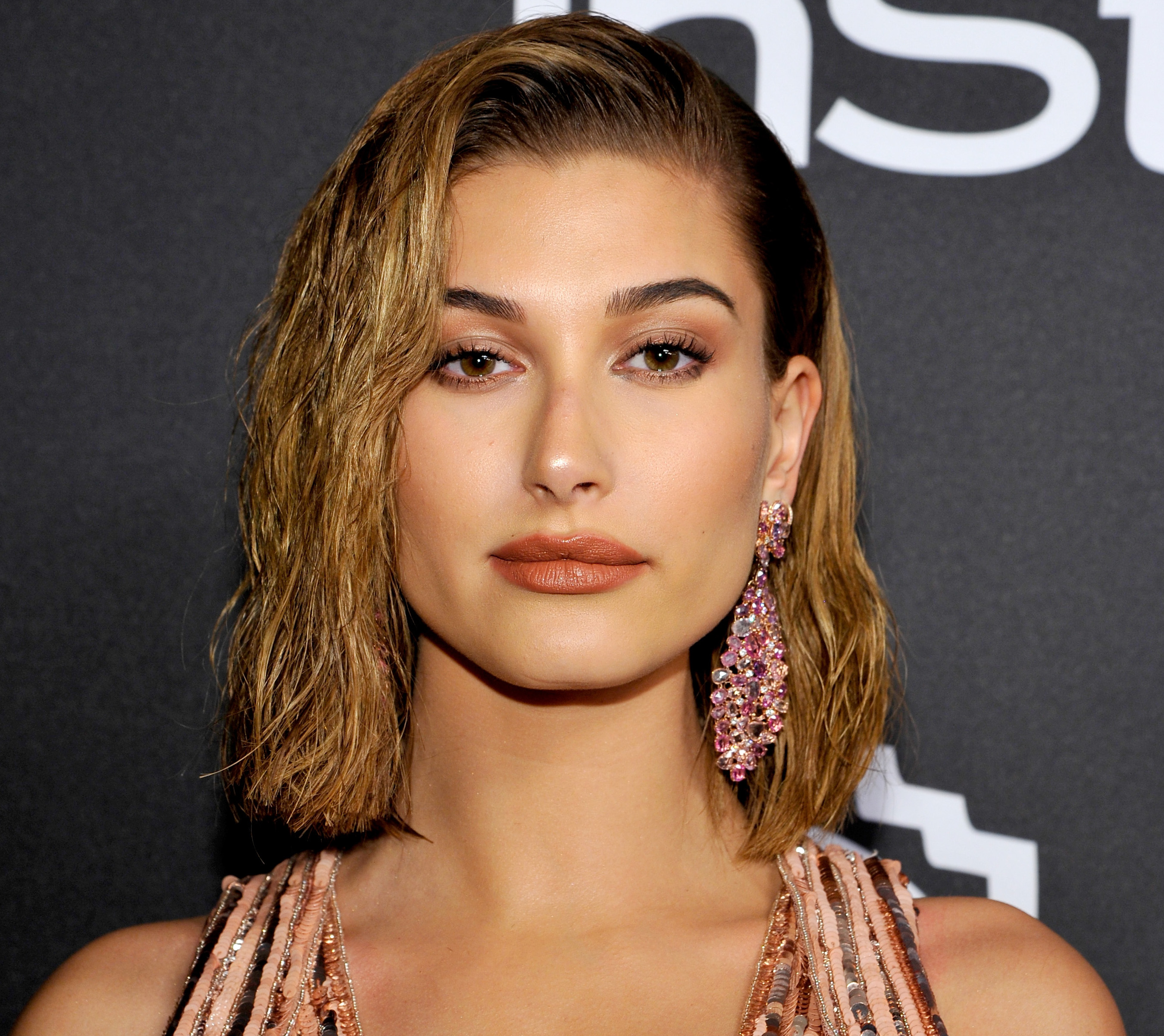 Hailey Baldwin just got two new tiny tattoos on her back and neck