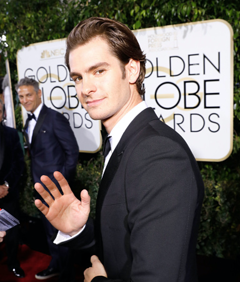 Andrew Garfield gave Emma Stone a supportive standing ovation during her Golden Globes win