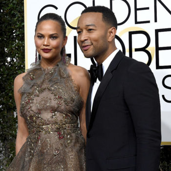Chrissy Teigen sat down on the Golden Globes red carpet to do her interview, because award shows are damn tiring