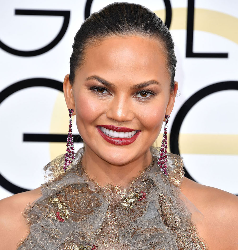 Chrissy Teigen had glowing skin at the Golden Globes thanks to Becca's new setting powder