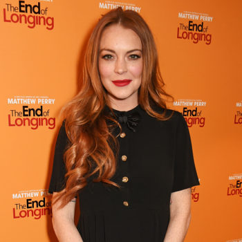Lindsay Lohan looks incredibly happy and confident in this elegant black-and-white look