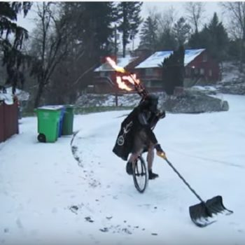 Here is a guy shoveling snow dressed as Darth Vader…on a unicycle…while playing flaming bagpipes