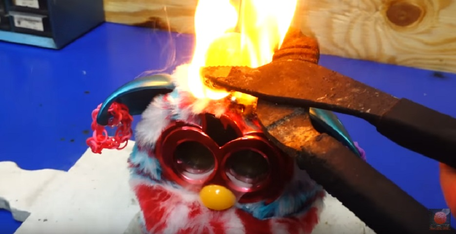 Someone destroyed a Furby with a red hot nickel ball, and it will totally creep you out