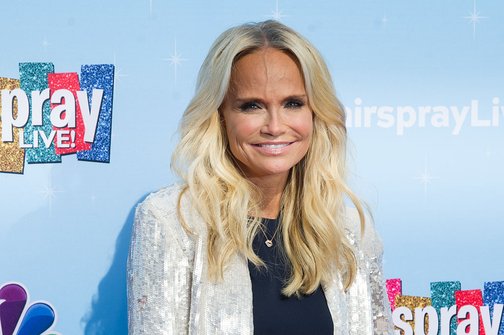 Kristin Chenoweth dresses and serenades her adorable puppy and we cannot handle the cuteness