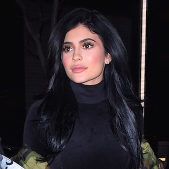 Kylie Jenner is giving us major Carmen Sandiego vibes in this red vinyl skirt and jacket