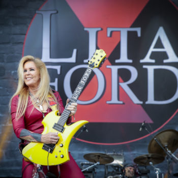 Rock n' roll pioneer Lita Ford talks about the music industry, self care, and her hair routine that's as epic as her guitar sound