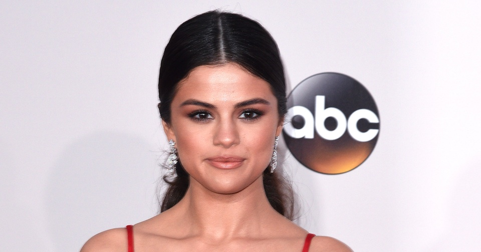 Selena Gomez somehow still managed to look chic while wearing a dinosaur sweater