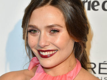 Elizabeth Olsen rocked a silk kimono-style robe on the red carpet like it was NBD