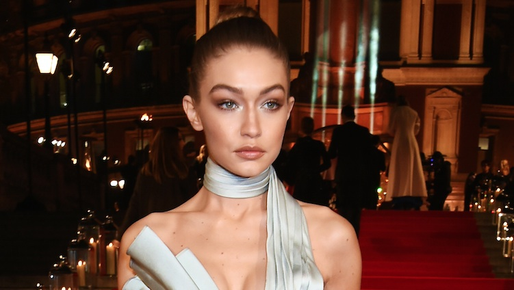 "Gigi Hadid's jacket and bell bottoms are giving us major ""That '70s Show"" vibes"