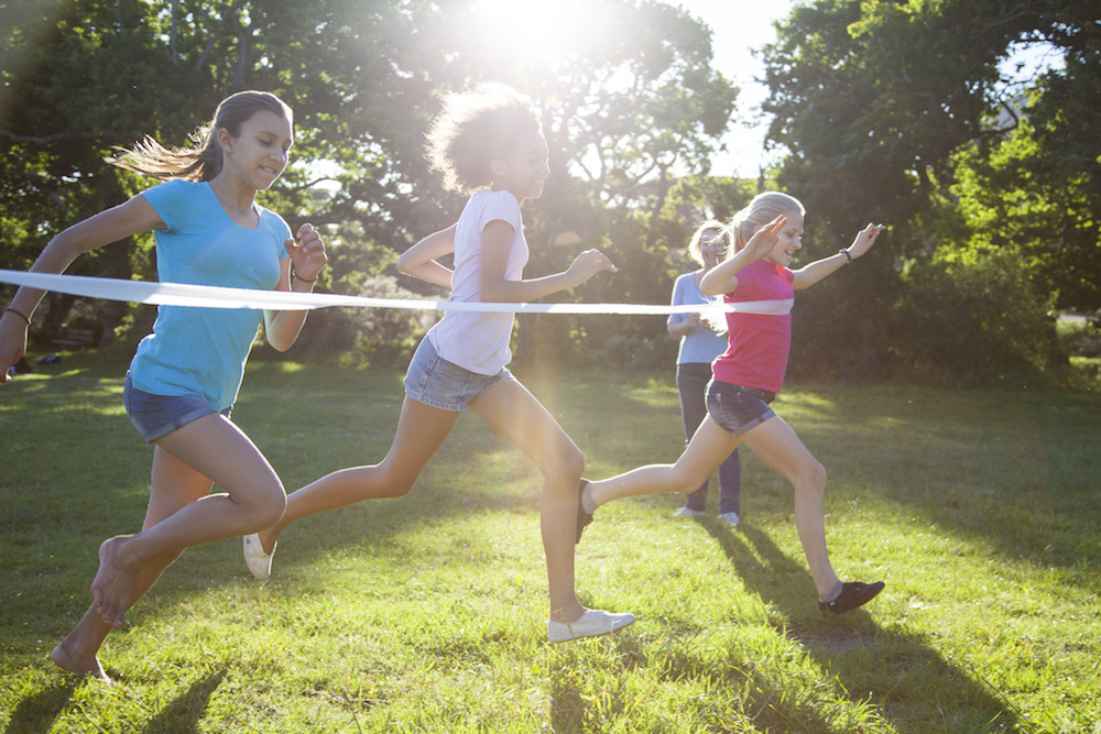 Group of girls running together in a race
