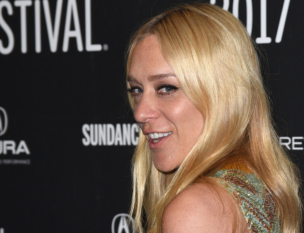 Chloe Sevigny's retro teal and gold mini dress makes us wish we were at a '70s disco party