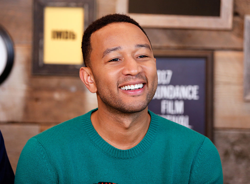 We kind of want to steal John Legend's animal sweater right off his back