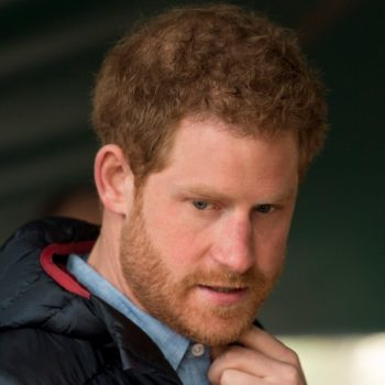 Prince Harry stands around like a literal male model (while also doing something awesome for his community)