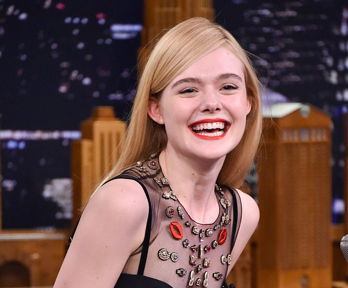 We are ready to settle a business deal with Elle Fanning in her bewitching boss pantsuit