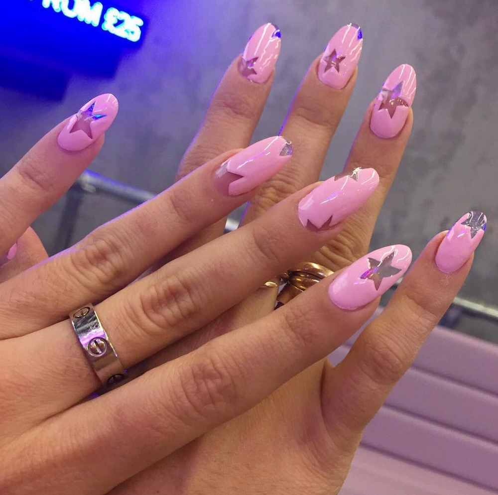 These pretty in pink nails are a clever way to do the negative space trend